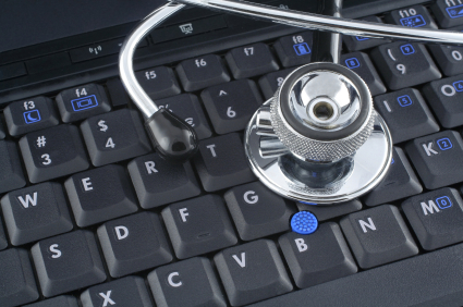 A stethoscope on a laptop keyboard