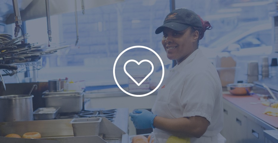 non-profit employee smiling with icon